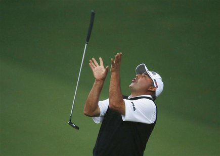 Angel Cabrera of Argentina flips his putter after missing a birdie putt on the second playoff hole during the 2013 Masters golf tournament a