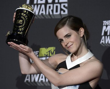 Emma Watson poses with the trailblazer award at the 2013 MTV Movie Awards in Culver City, California April 14, 2013. REUTERS/Phil McCarten