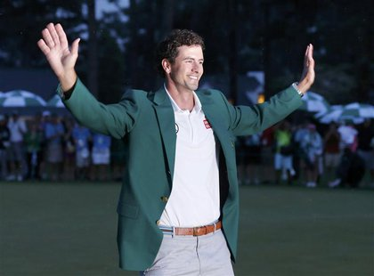 Adam Scott of Australia celebrates with his green jacket after winning the 2013 Masters golf tournament at the Augusta National Golf Club in