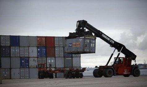 A worker unloads a container using a forklift at a port in Lisbon March 12, 2013. REUTERS/Rafael Marchante