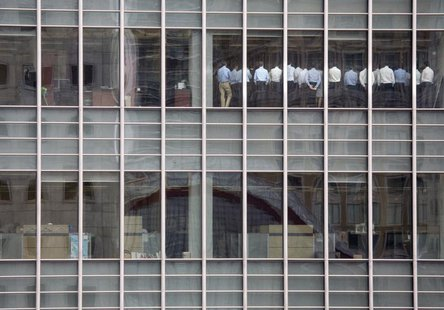 Staff stand in a meeting room at Lehman Brothers offices in the financial district of Canary Wharf in London in this September 11, 2008 file