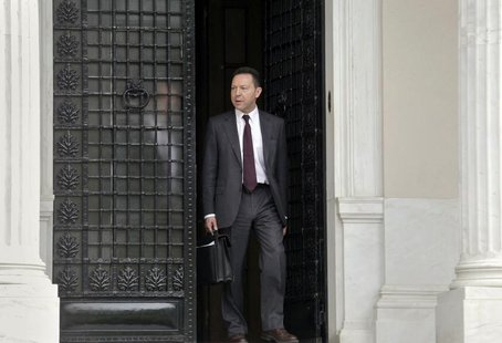Greek Financial Minister Yannis Stournaras walks off the Premier's office after a meeting with the Greek Prime Minister and the Troika in At