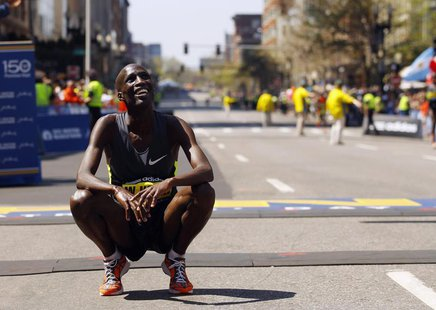 Wesley Korir of Kenya smiles after crossing the finish line to win the men's division of the 116th Boston Marathon in Boston, Massachusetts
