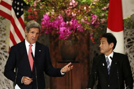 U.S. Secretary of State John Kerry (L) speaks next to Japan's Foreign Minister Fumio Kishida during their joint news conference after their