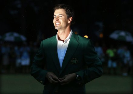 Adam Scott of Australia buttons his green jacket after winning the 2013 Masters golf tournament at the Augusta National Golf Club in Augusta