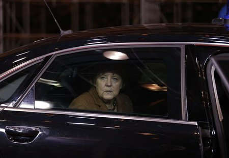 Germany's Chancellor Angela Merkel arrives at the EU council headquarters for an European Union leaders summit discussing the European Union