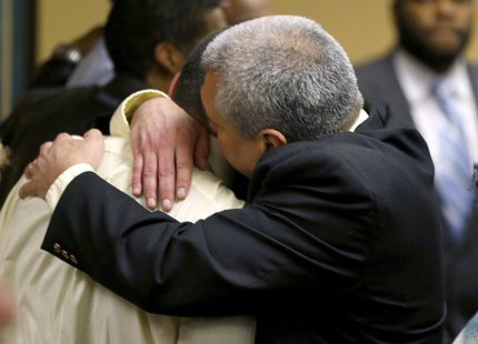 Brian Mays (R), hugs his son, Trent, after hearing the verdict in juvenile court in Steubenville, Ohio, March 17, 2013. REUTERS/Keith Srakoc