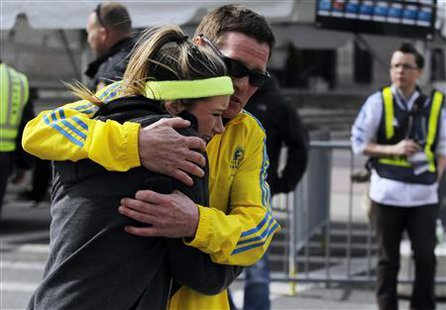 A woman is comforted by a man near a triage tent set up for the Boston Marathon after explosions went off at the 117th Boston Marathon in Boston, Massachusetts April 15, 2013. (Reuters)