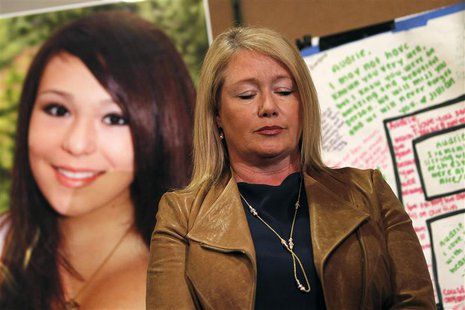Sheila Pott pauses in front of a portrait of her teenage daughter, Audrie Pott, at a news conference in San Jose, California April 15, 2013.