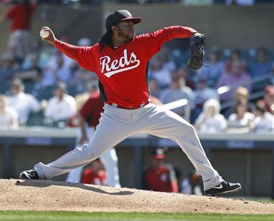Cincinnati Reds starting pitcher Johnny Cueto delivers a pitch against the Arizona Diamondbacks during the first inning of their MLB Cactus
