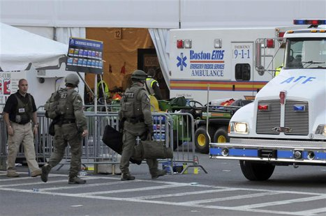 Agents from several federal agencies including the FBI and ATF arrive on scene after explosions near the finish line of the Boston Marathon
