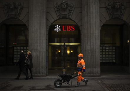 A construction worker walks past a building of Swiss bank UBS in Zurich, April 12, 2013. REUTERS/Michael Buholzer