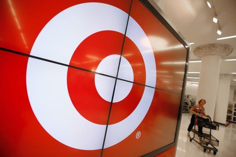 A vendor pushes a shopping cart through the new CityTarget store as it is getting stocked for the opening in downtown Chicago July 18, 2012.