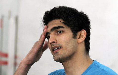 Indian boxer Vijender Singh reacts during an interview at Karnail Singh stadium in New Delhi April 2, 2012. REUTERS/Parivartan Sharma