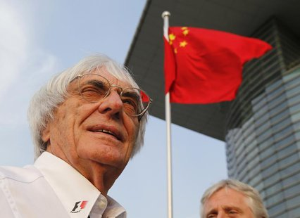 Formula One supremo Bernie Ecclestone is seen in front of Chinese national flag at a paddock after the qualifying session for the Chinese F1