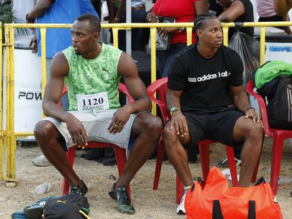 Jamaican runners Usain Bolt (L) and Yohan Blake prepare to run in the men's 400m race of the Camperdown Classic, an annual track event in it