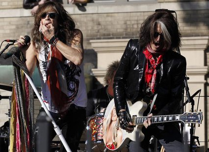 Aerosmith's Steven Tyler (L) and Joe Perry perform in front of their old apartment building in Allston, Massachusetts November 5, 2012. REUT