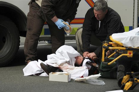 A victim is attended to at the scene of an explosion at the Boston Marathon in Boston, Massachusetts, April 15, 2013. REUTERS/Daily Free Pre