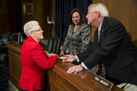 Gina McCarthy speaks with U.S. Senators Deb Fischer (R-NE) and Roger Wicker (R-MS) prior to testifying before the Senate Environment and Pub