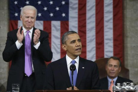 U.S. President Barack Obama (C), flanked by Vice President Joe Biden (L) and House Speaker John Boehner (R-OH), delivers his State of the Un