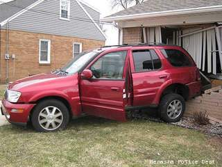Vehicle slams into house in Menasha on April 15, 2013.