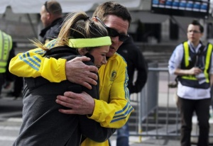 Runners comfort each other after twin bombings at the end of the Boston Marathon. (Reuters)