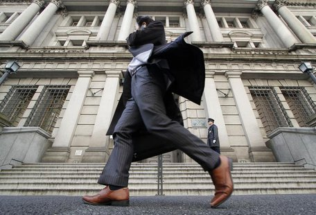 A man walks past the Bank of Japan building in Tokyo March 17, 2010. REUTERS/Toru Hanai