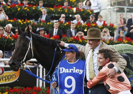 Jockey Luke Nolen (R) embraces Black Caviar trainer Peter Moody after winning the TJ Smith Stakes at Royal Randwick racecourse in Sydney Apr