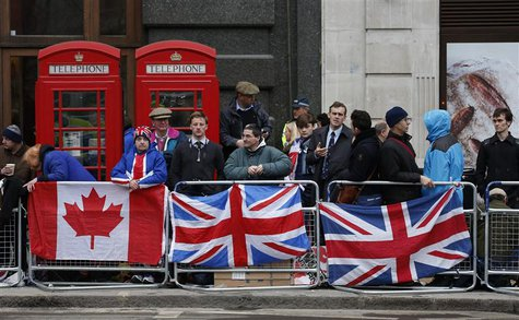 Spectators gather on the route to watch the funeral procession of former British prime minister Margaret Thatcher, near St Paul's Cathedral