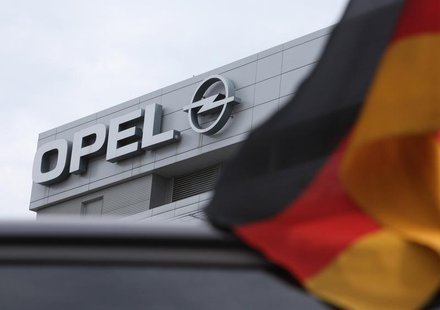 A German flag flatters in the wind in front of the Opel headquarters in Ruesselsheim June 9, 2010. REUTERS/Ralph Orlowski
