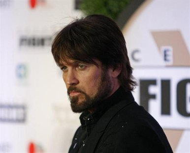 Recording artist Billy Ray Cyrus arrives on the red carpet at the Muhammad Ali Celebrity Fight Night Awards XIX in Phoenix, Arizona March 23
