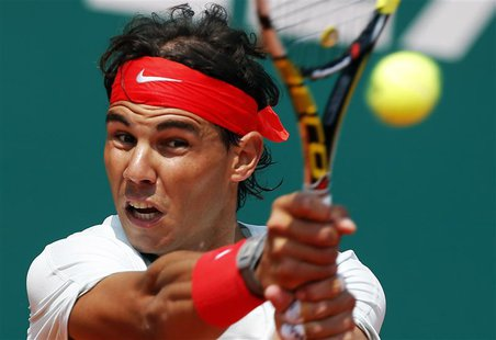 Rafael Nadal of Spain returns the ball to Marinko Matosevic of Australia during the Monte Carlo Masters in Monaco April 17, 2013. REUTERS/Er