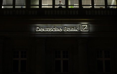 The logo of Germany's largest business bank, Deutsche Bank, is illuminated at the bank's original headquarters in Frankfurt January 31, 2012
