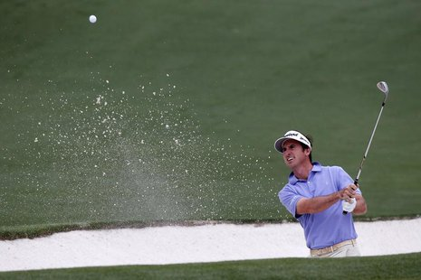 Gonzalo Fernandez-Castano of Spain hits from a sand trap on the second hole during final round play in the 2013 Masters golf tournament at t