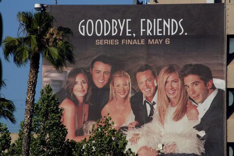 "The cast of the popular comedy television series ""Friends,"" which will end its ten year run on May 6, 2004, are pictured on a giant billboar"