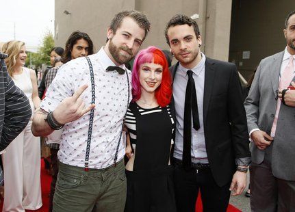 Jeremy Davis (L), Hayley Williams and Taylor York, of the band Paramore, arrive at the 2013 MTV Movie Awards in Culver City, California Apri