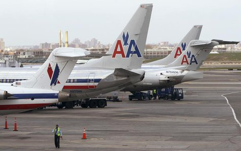 American Airlines aircraft sit on the tarmac at LaGuardia airport following a reservation system outage in New York, April 16, 2013. REUTERS