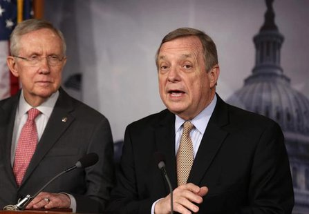 Senator Dick Durbin (D-IL) speaks next to Senate Majority Leader Harry Reid (D-NV) (L) at a news conference on Capitol Hill in Washington Fe
