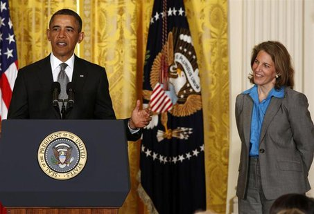 U.S. President Barack Obama stands next to Sylvia Mathews Burwell, head of the Walmart Foundation, while nominating her to become director o