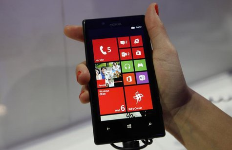 The new Nokia Lumia 720, featuring the same camera lens as the higher end Lumia 920, is pictured during the Mobile World Congress in Barcelo