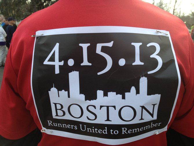Racers wore special bibs to honor those impacted by the Boston Marathon bombings - Kalamazoo Solidarity Run