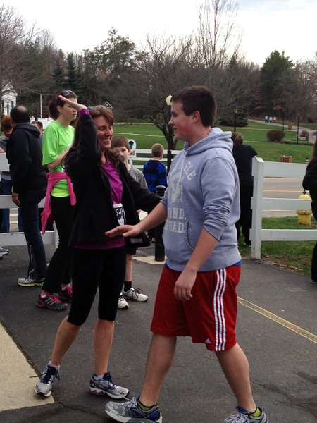 High fives at the finish line - Kalamazoo Solidarity Run