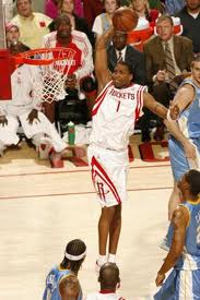 Tracys McGrady gets up high for a dunk while playing for the Houston Rockets.
