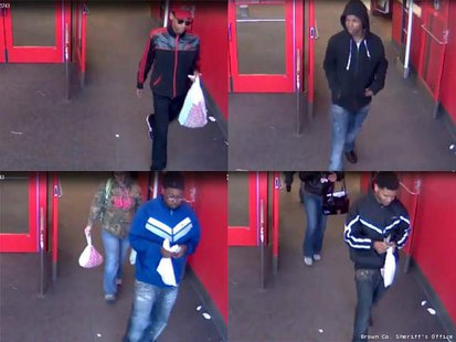 Suspects caught on video surveillance at Target in Bellevue on April 11th.  (Photo courtesy of Fox 11 WLUK-TV)