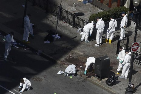 Officials take crime scene photos two days after two explosions hit the Boston Marathon in Boston, Massachusetts April 17, 2013. REUTERS/Sha