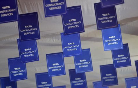 Logos of Tata Consultancy Services (TCS) are displayed at the venue of the annual general meeting of the software services provider in Mumba