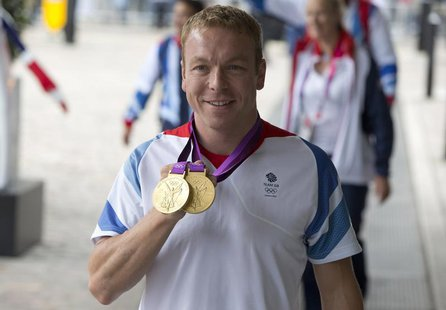 Olympic cyclist Chris Hoy poses for photographers as he arrives for a reception for British Olympic and Paralympic athletes in London Septem