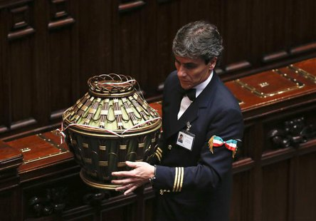 A parliamentary assistant carries a ballot box at the end of the presidential election in the lower house of the parliament in Rome April 18