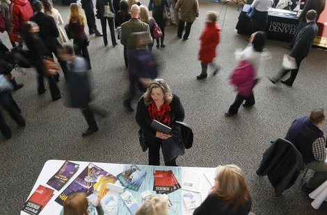 A job seeker (C) talks to an exhibitor at the Colorado Hospital Association health care career fair in Denver April 9, 2013. REUTERS/Rick Wi