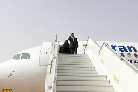 Iranian President Mahmoud Ahmadinejad waves as he arrives at Niamey airport April 15, 2013. REUTERS/Arash Khamooshi/ISNA/Handout